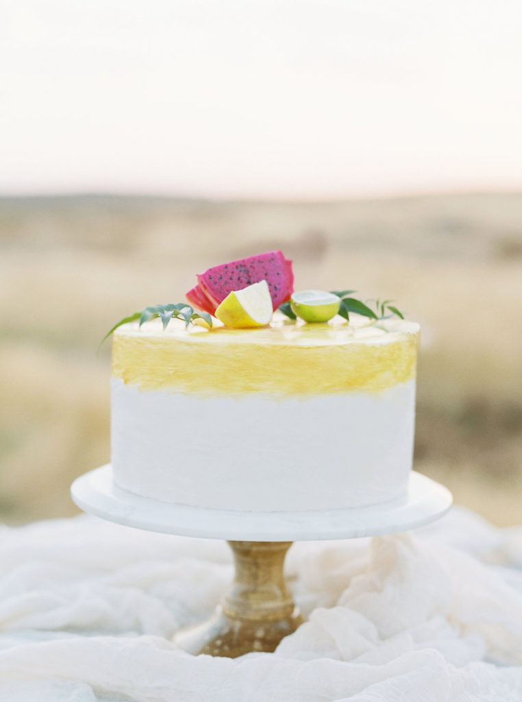 Fruity cake on marble and wood cake stand
