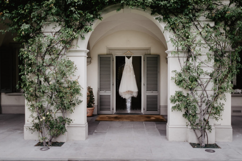 Wedding gown hanging at the window