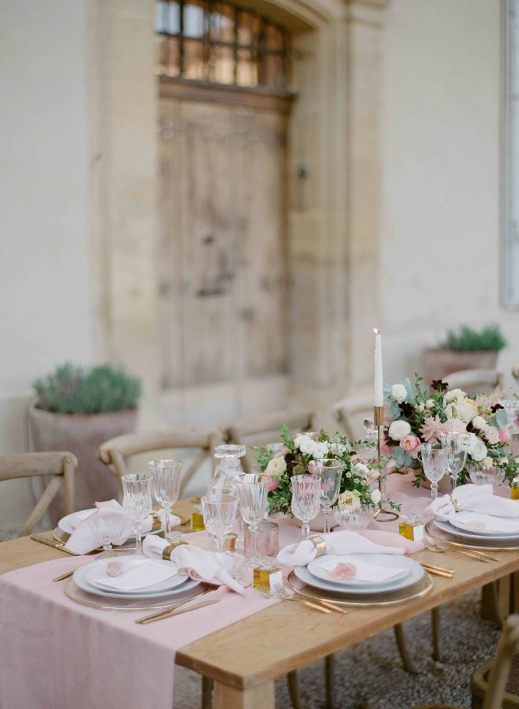 Wedding table decor with crystal glassware, blush and gold accents