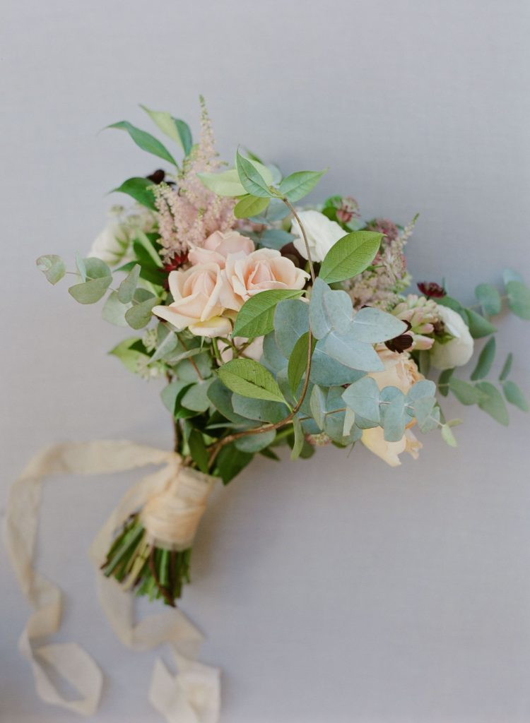 Bridal bouquet in tones of blush, sage and Burgundy red