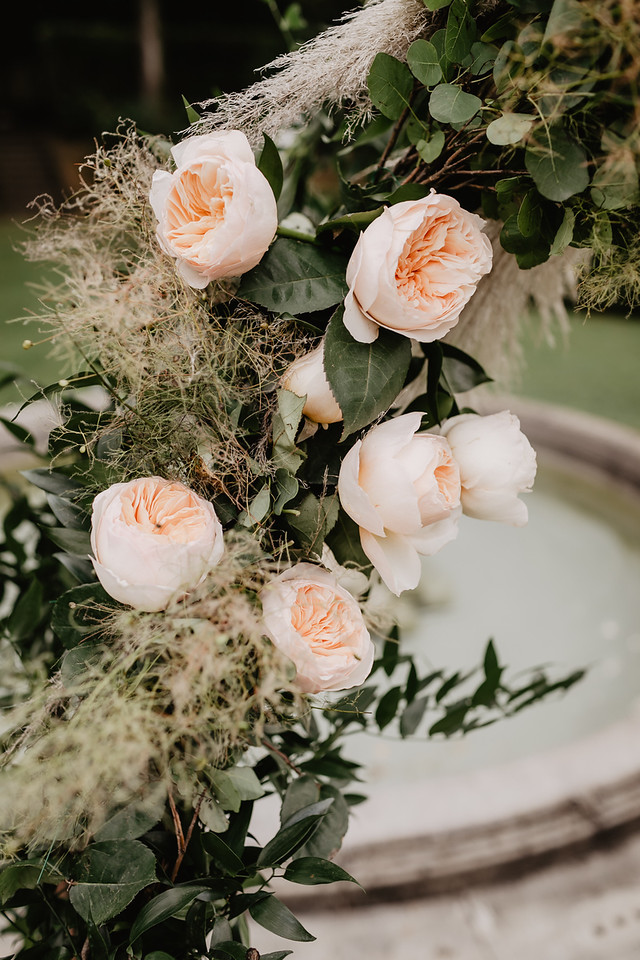 Wedding arch floral decor closeup with pampa grass and Juliet roses