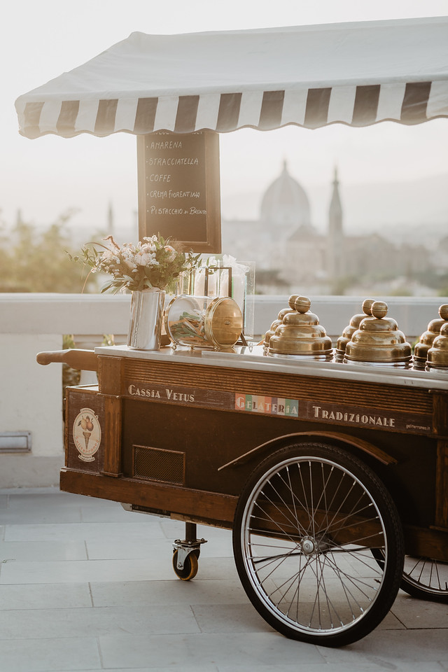 Organic ice cream served from a vintage cart at an Italian wedding