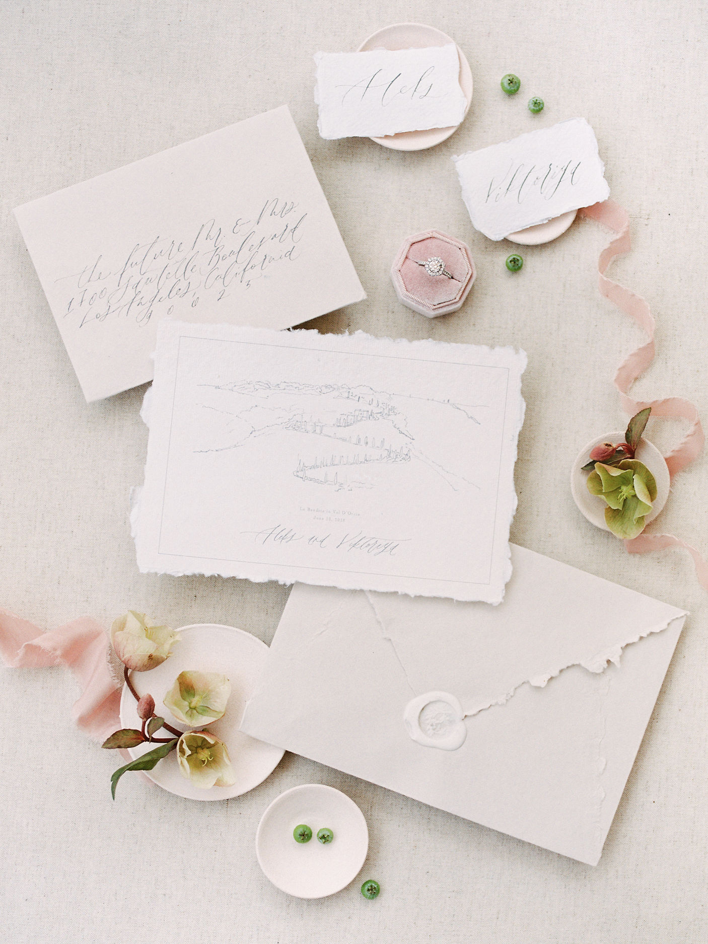 Calligraphed wedding invitation suite on handmade paper