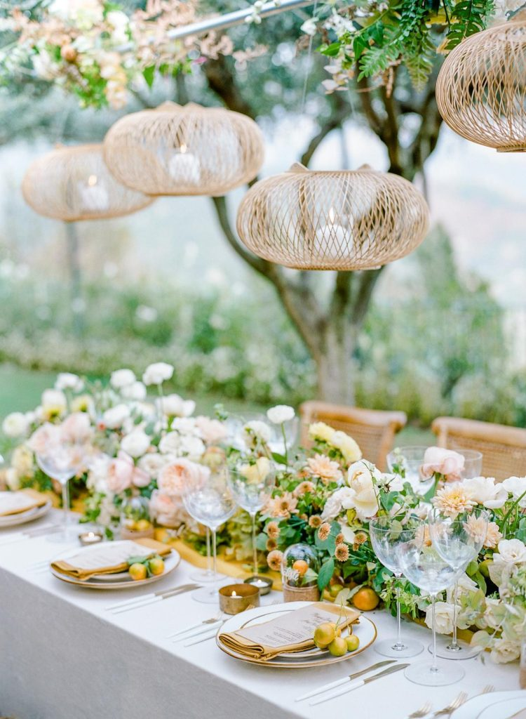 Vibrant wedding table decor in tones of pink, yellow, orange and teal
