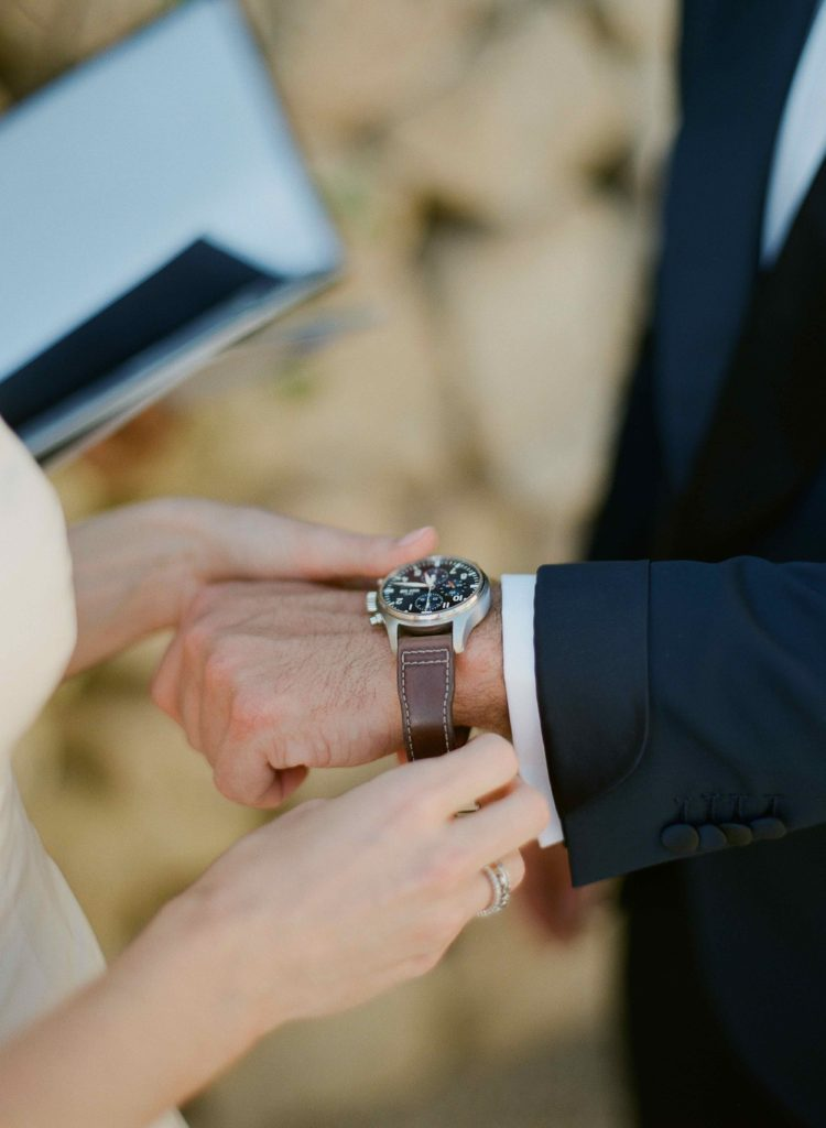 A wristwatch is given to the groom in lieu of the traditional wedding ring